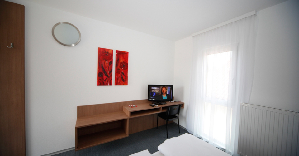 Vollausgestattete Zimmer und Apartments mit Flat TV